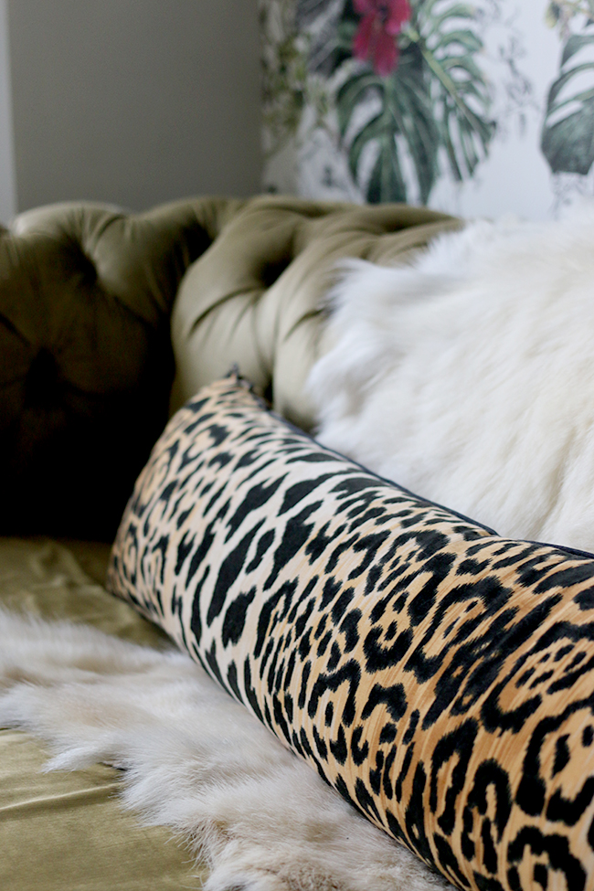 eclectic boho glam style - goats hair hide and leopard print bolster pillow