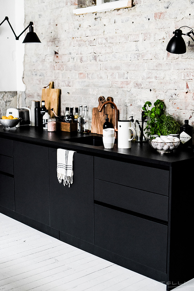 copper-tap-with-black-cupboards