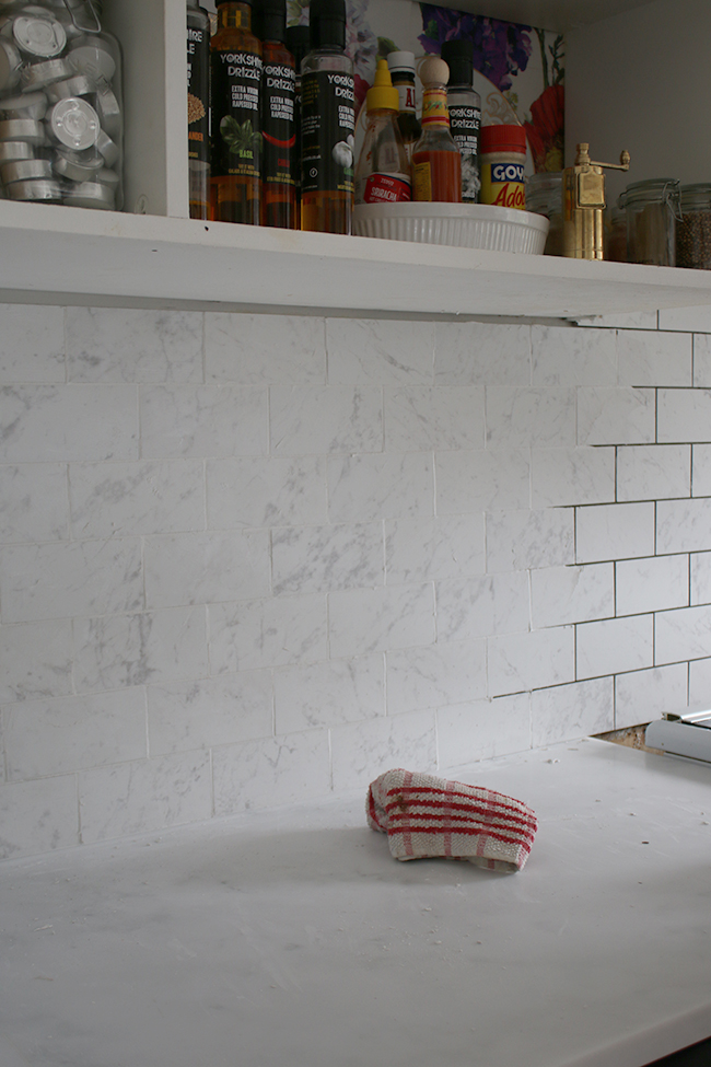 Half way through re-tiling the kitchen using Tile Mountain's marble effect porcelain tiles
