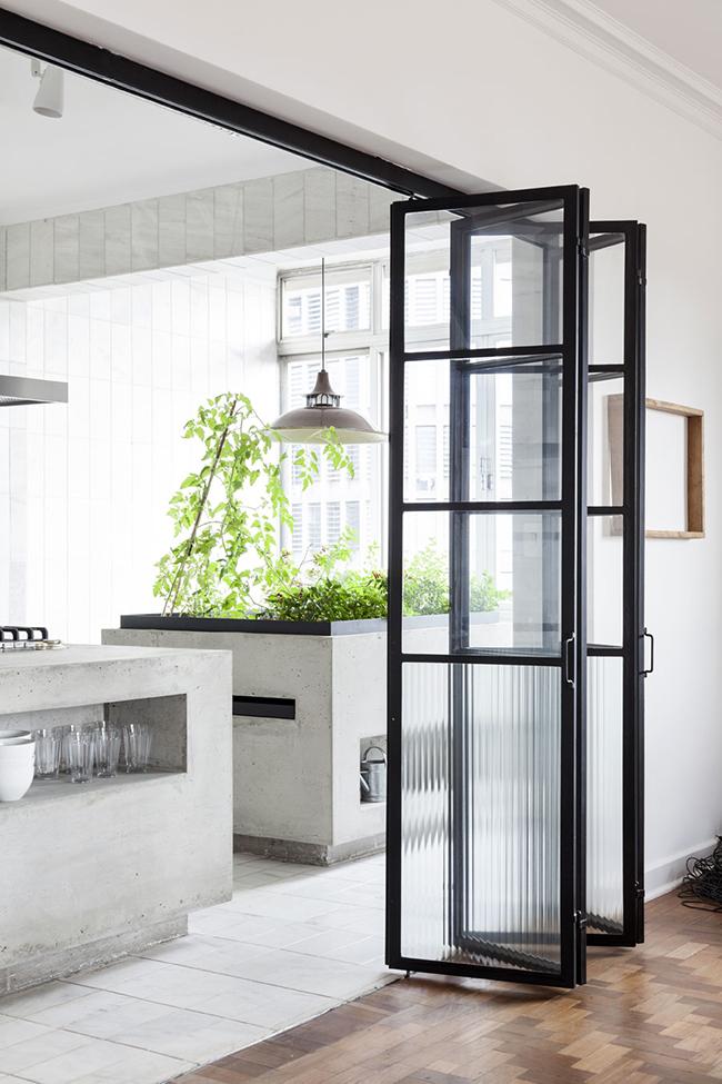 glazed folding steel doors into kitchen