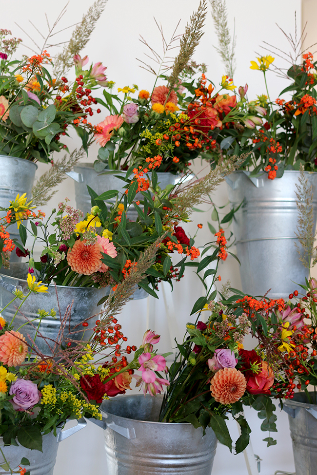 flowers in silver pots on display