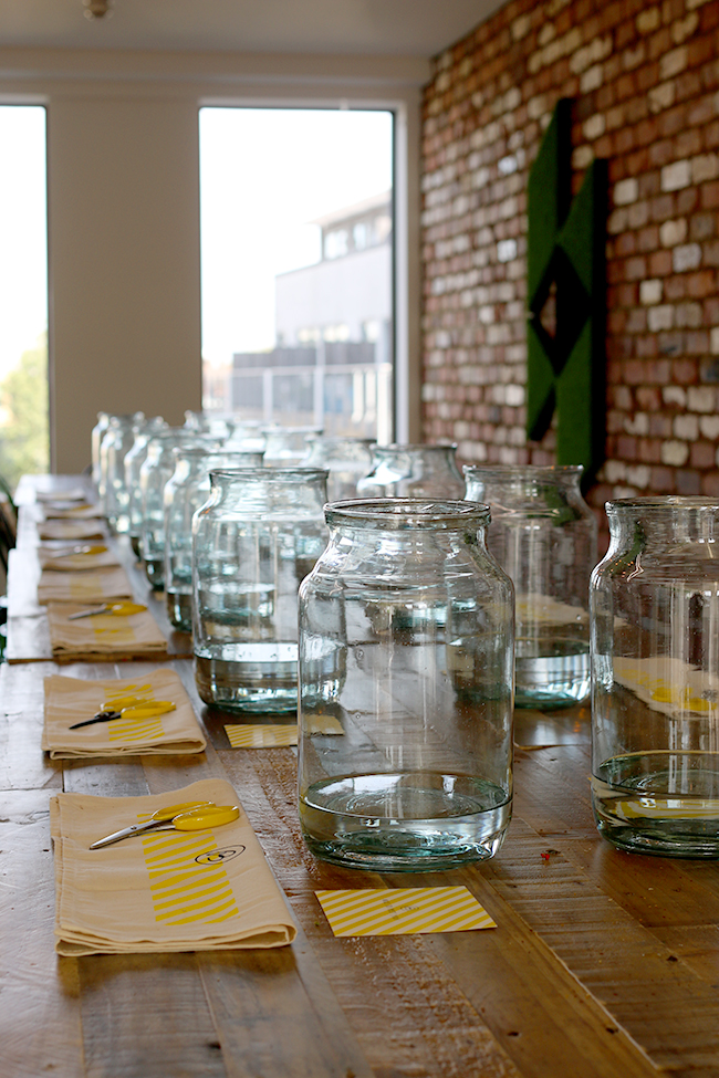 empty glass vases in a row on a table