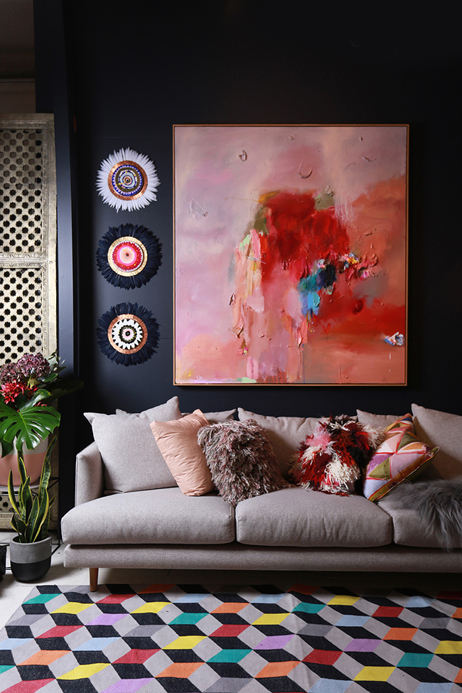 dark walls with blush pink artwork