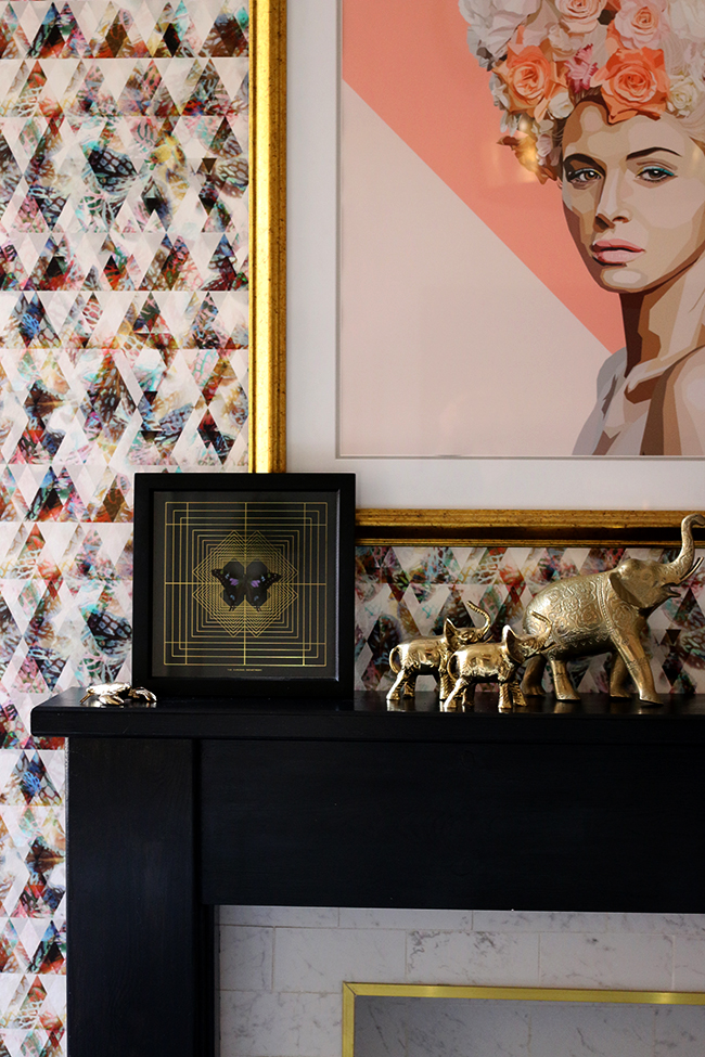 dining room mantle with artwork and gold elephants