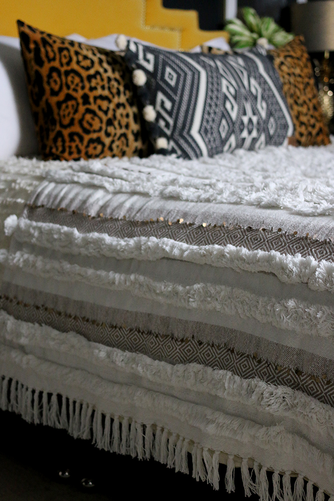 moroccan style wedding blanket with leopard print cushions