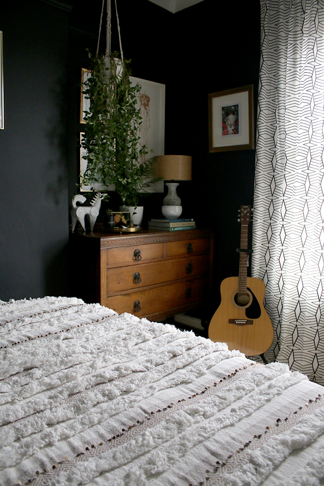 vintage chest of drawers with plants and moroccan throw bedroom