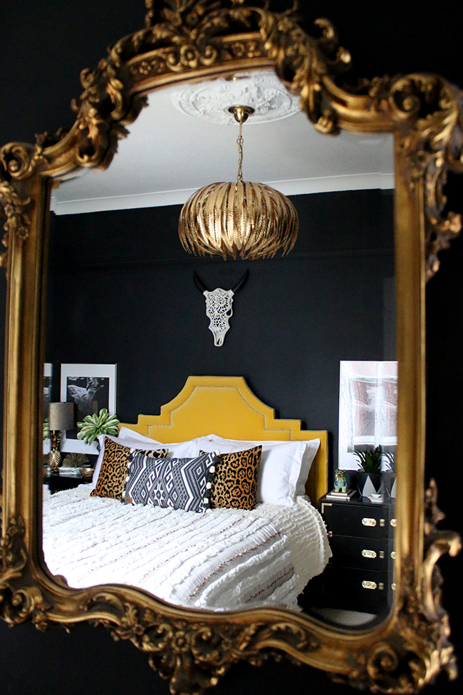 mirror reflection of eclectic boho glam bedroom in neutrals