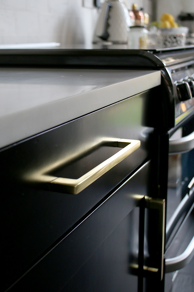 black kitchen cupboards with gold hardware