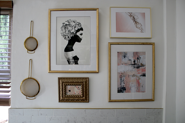 kitchen gallery wall with pink black and white and gold