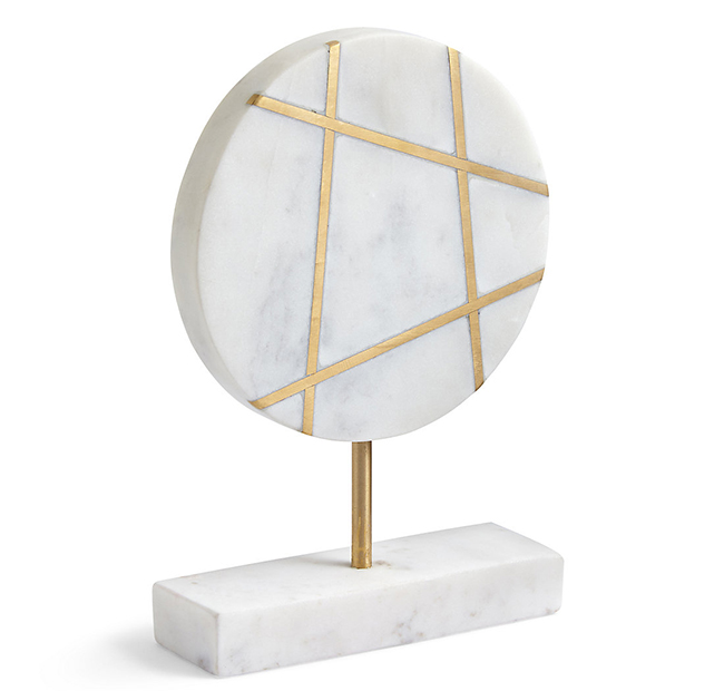 coran medallian from marks and spencer in marble and gold