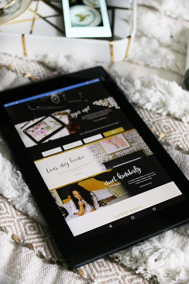 tablet showing Swoon Worthy website on textural bedding