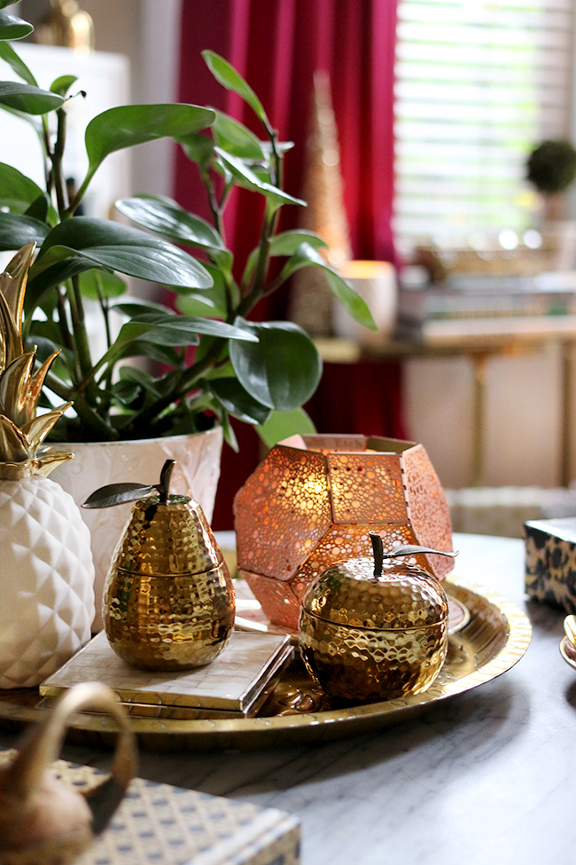 Coffee table vignette styling in gold copper and white christmas styling - see more at www.swoonworthy.co.uk