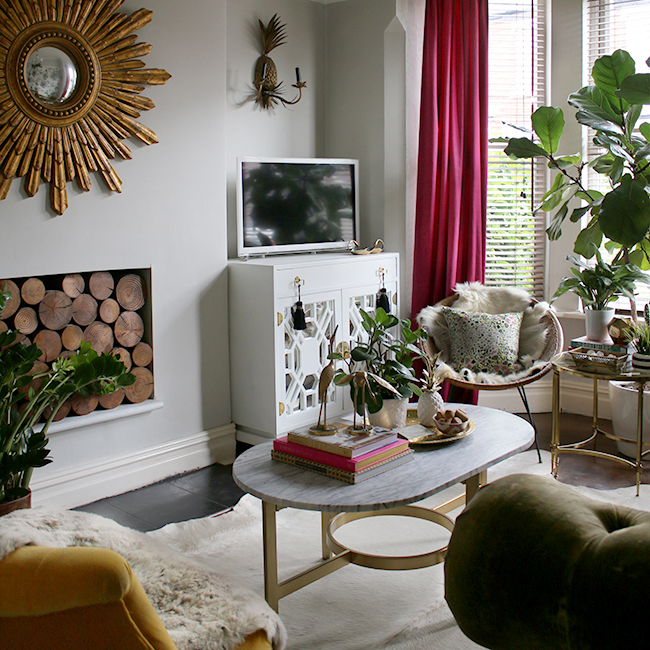 swoon worthy living room with vintage painted cabinet and sunburst mirror