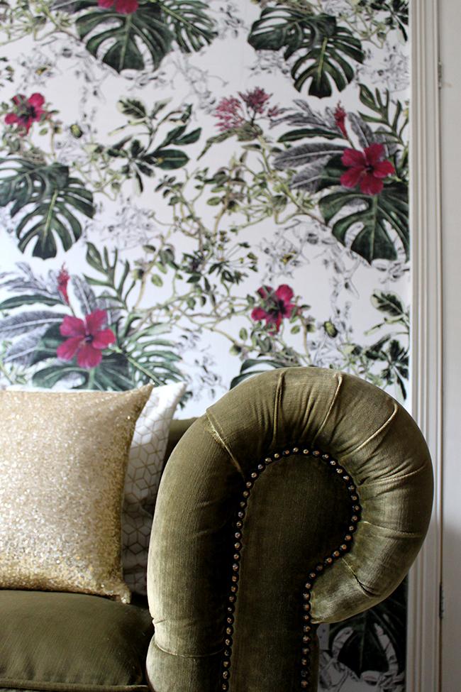 corner of olive green chesterfield sofa