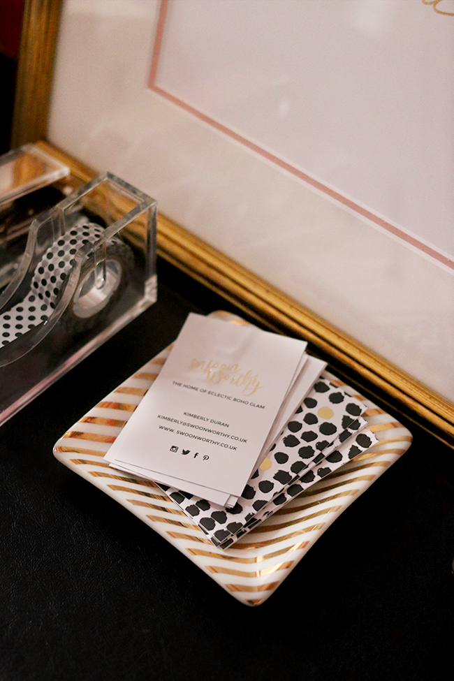 Swoon Worthy business card design on desk gold black polkadots design