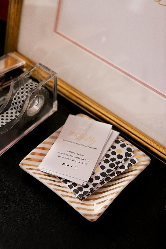 swoon worthy business card design on desk gold black polkadots design