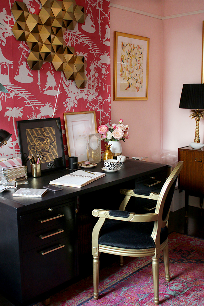 eclectic boho glam office with blush pink walls and black and gold accents
