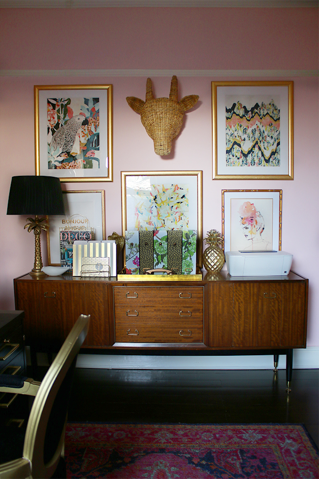 Boho glam office with gallery wall and mid-century modern sideboard