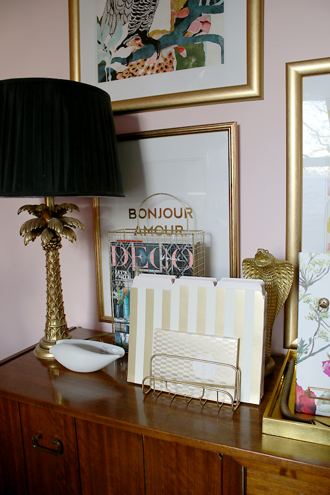 Gold office accessories in a blush pink office