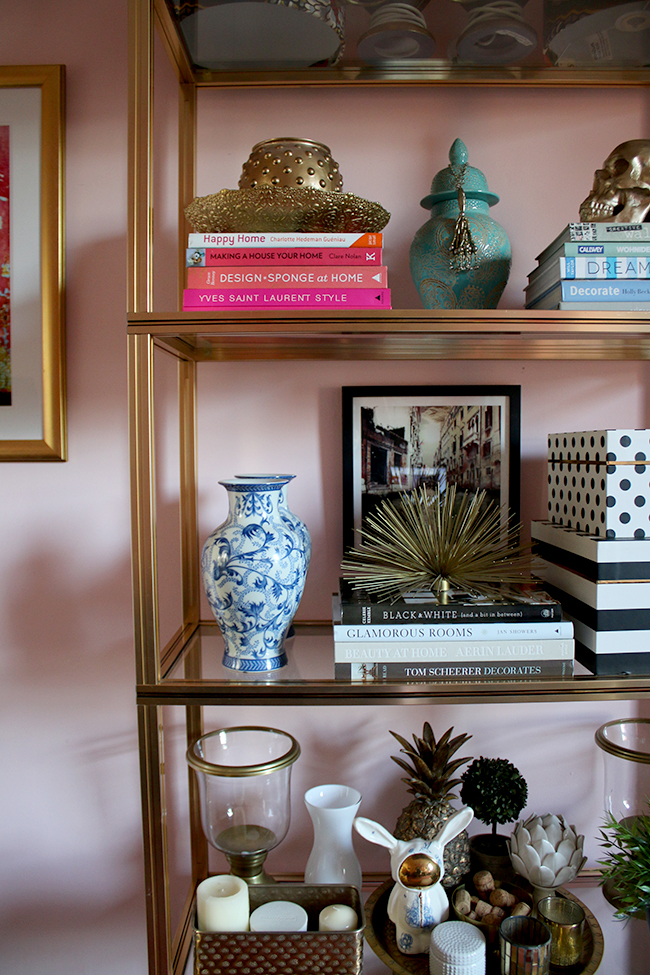 Pierre Vandel gold shelving unit in blush pink office