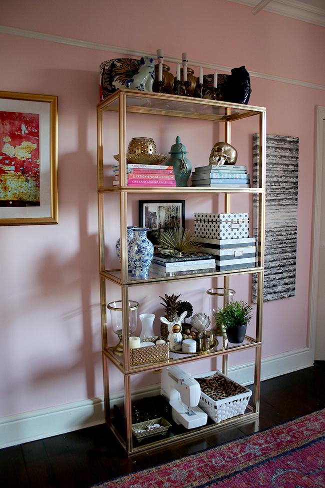 pierre vandel brass shelving unit in blush pink office