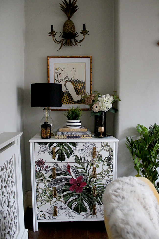 wallpapered chest of drawers with tropical print and leigh viner print