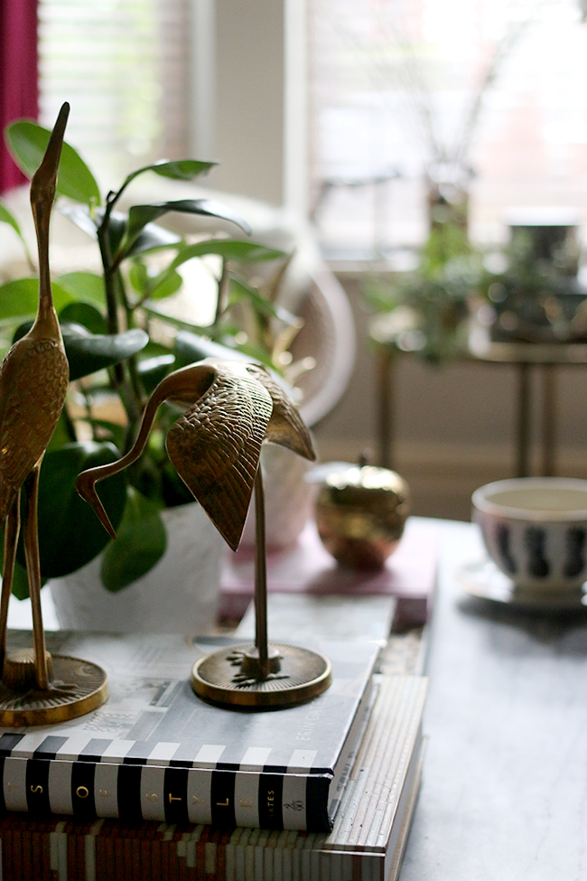 coffee table styling with brass cranes