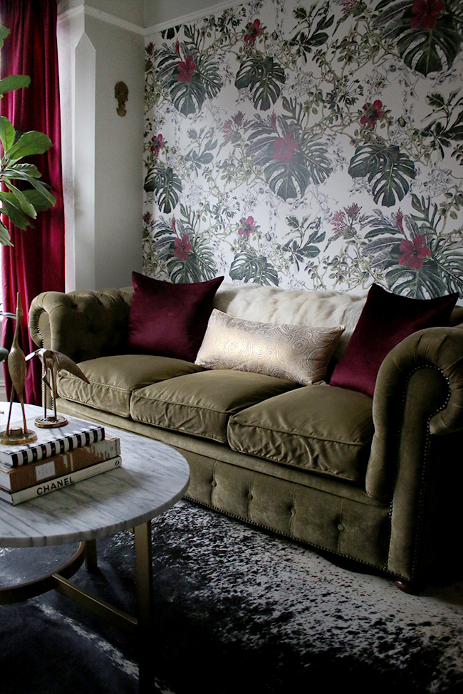 eclectic boho glam in deep claret and olive green chesterfield and tropical wallpaper