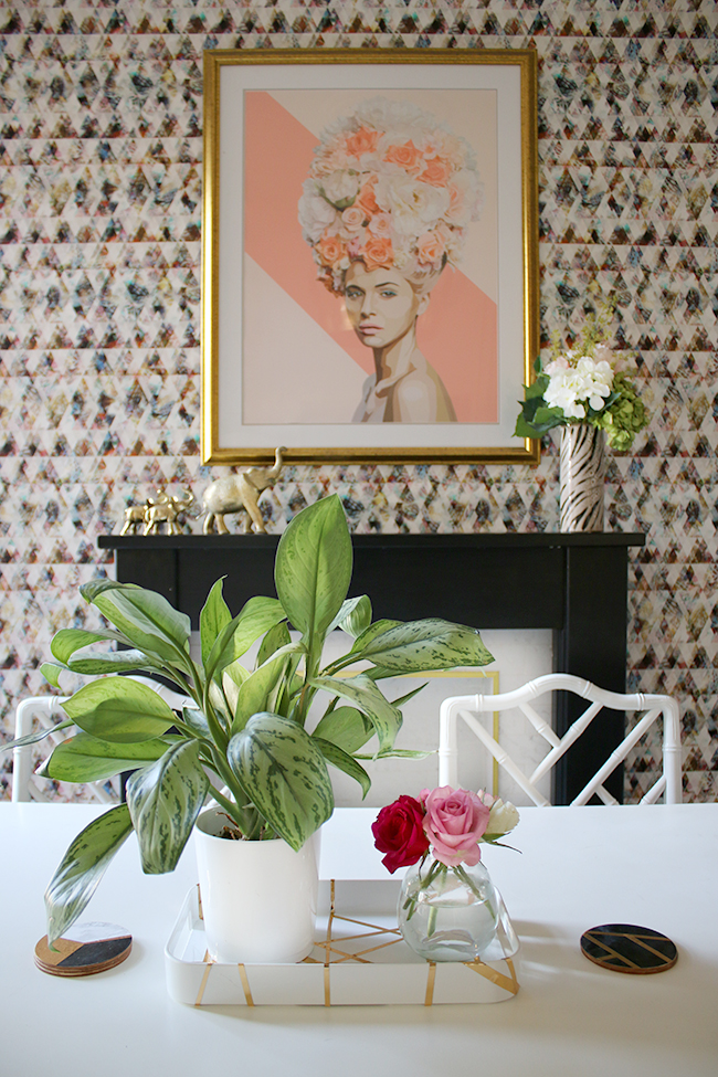 fireplace with colourful wallpaper and dining table