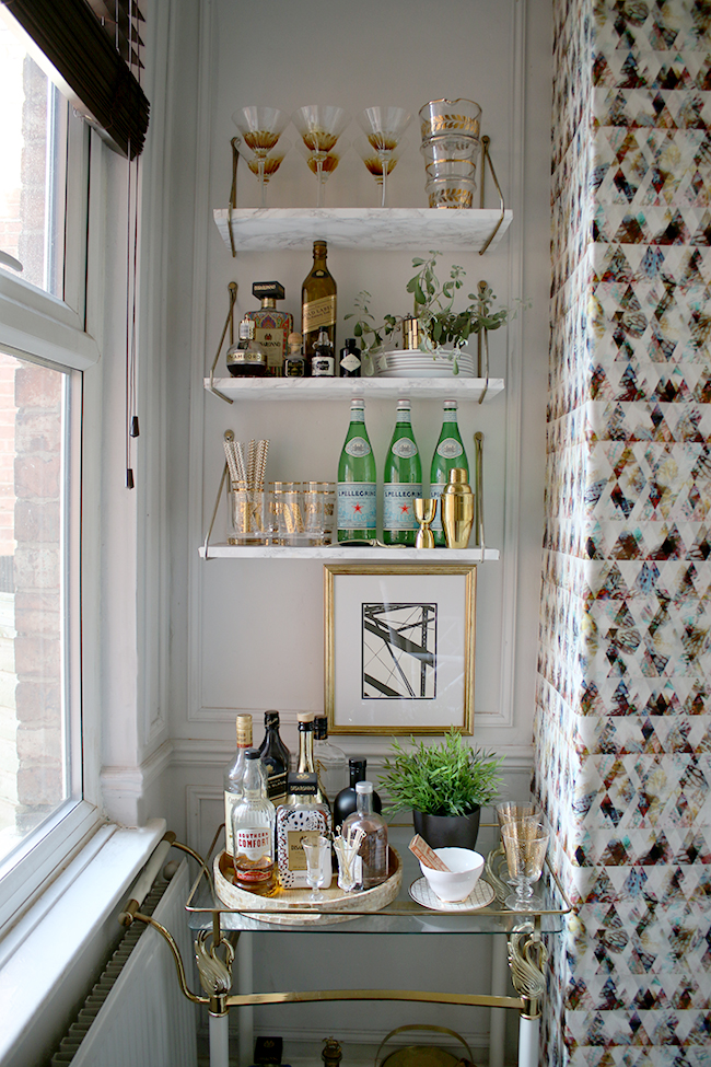 bar cart with marble look shelving
