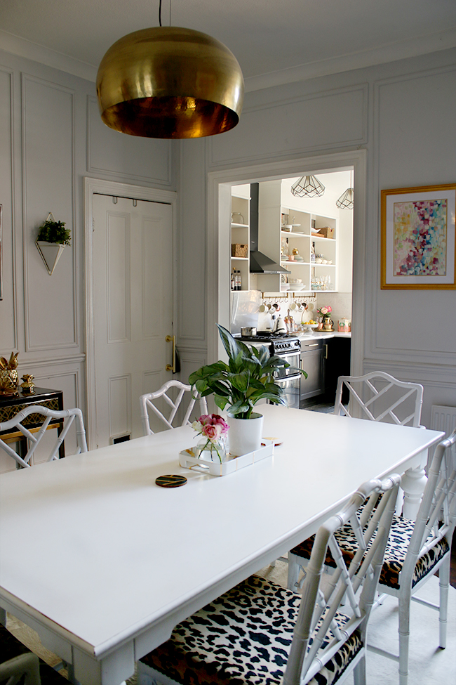 dining room with white cowhide and leopard print chairs