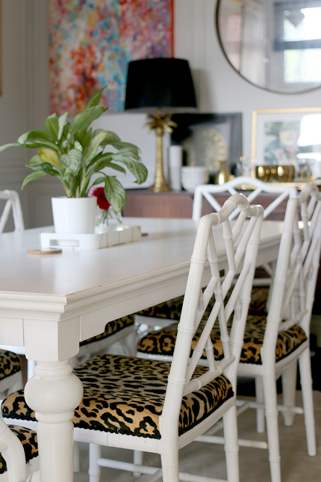 dining room with faux bamboo chairs and leopard print seats
