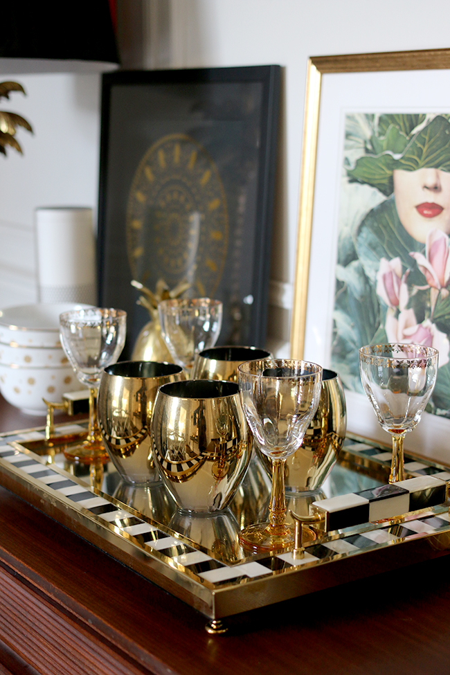gold and black tray detail with gold glasses