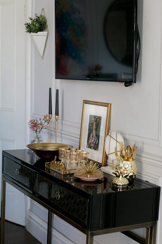 black sideboard with television