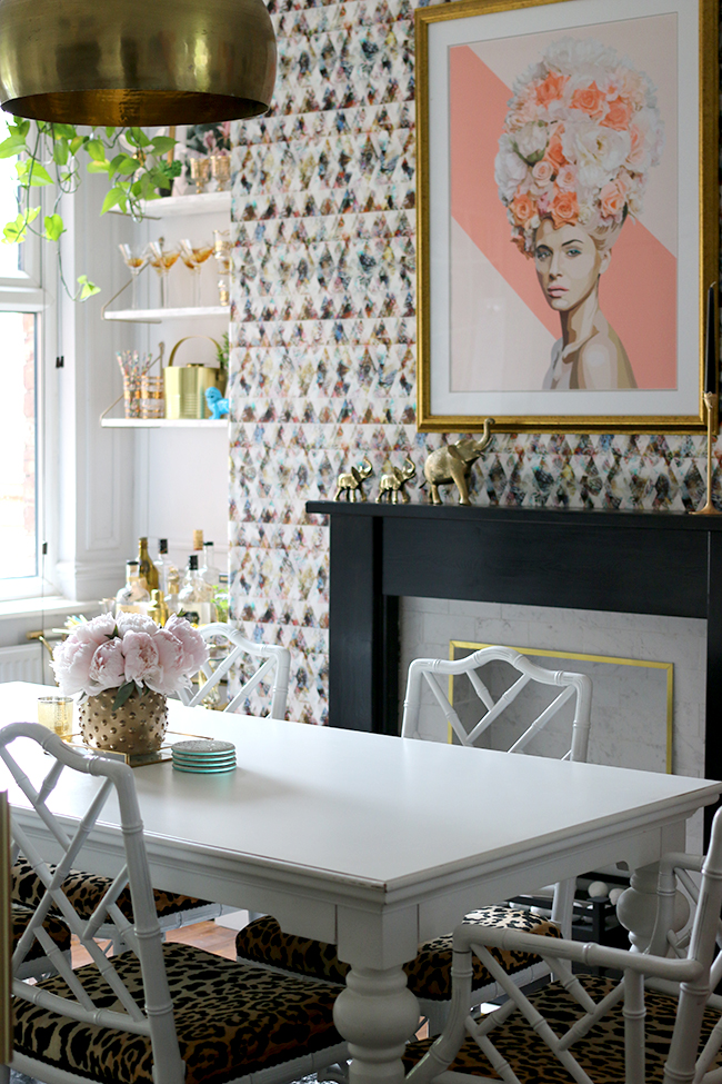 dining room with graphic wallpaper in white and pink