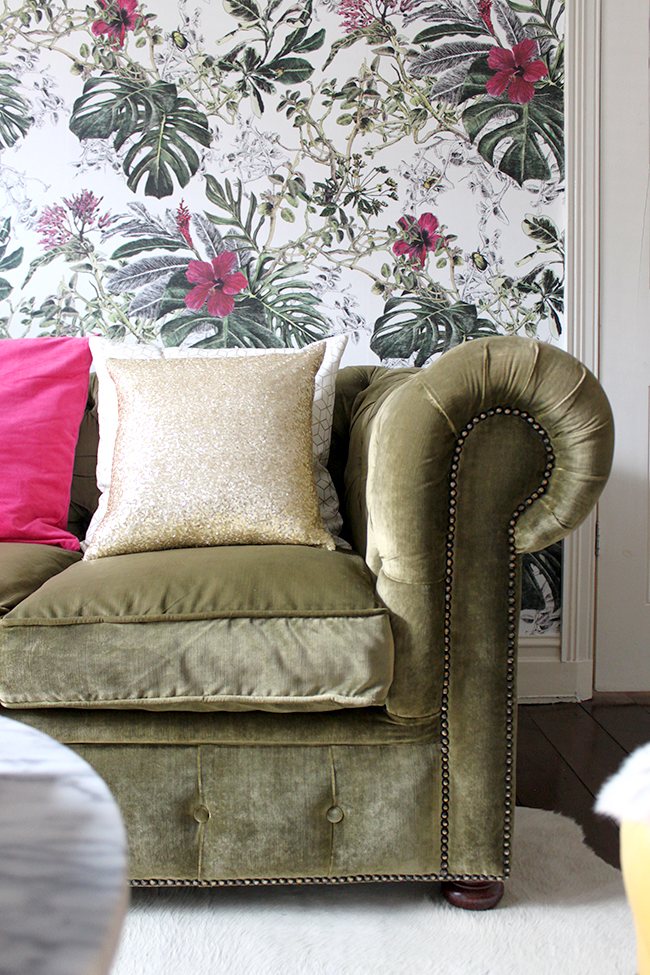 olive velvet chesterfield sofa with botanical wallpaper