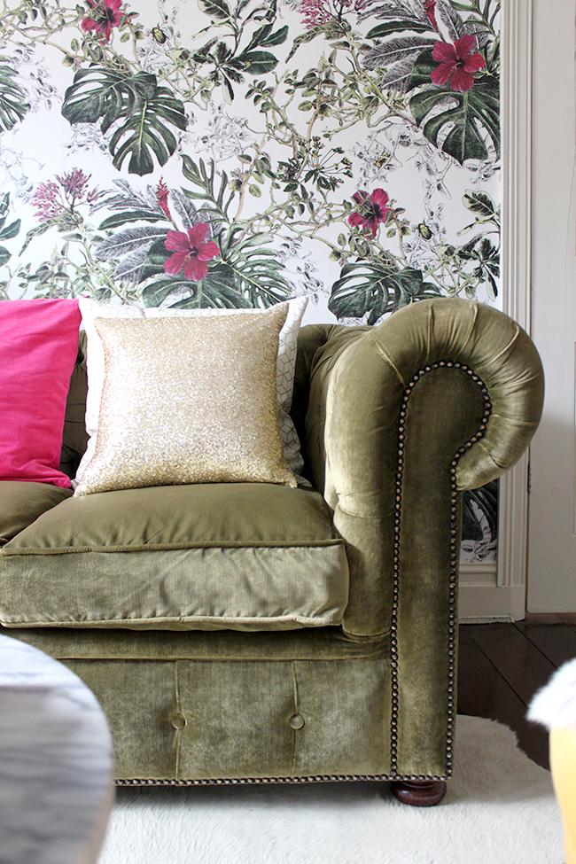 olive velvet chesterfield sofa with botanical wallpaper