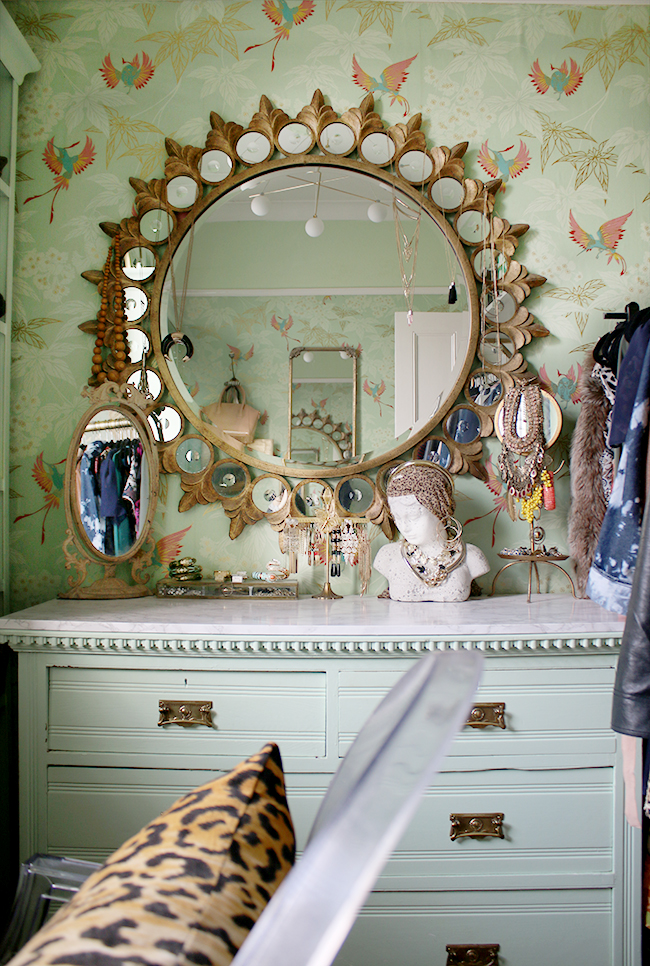 dressing room round mirror with mint green wallpaper