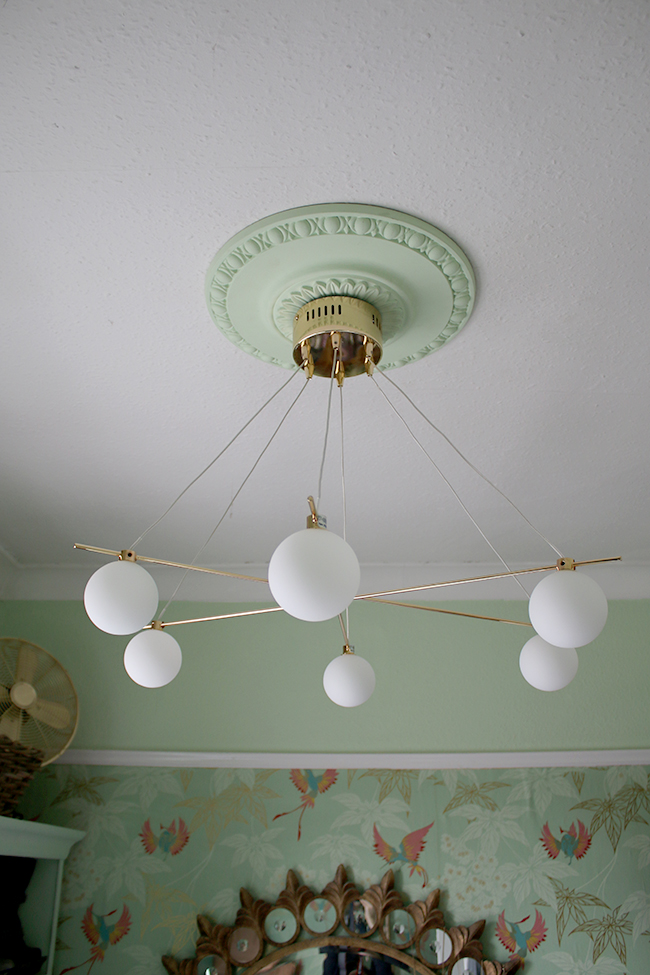 brass and glass globe light fitting from Next