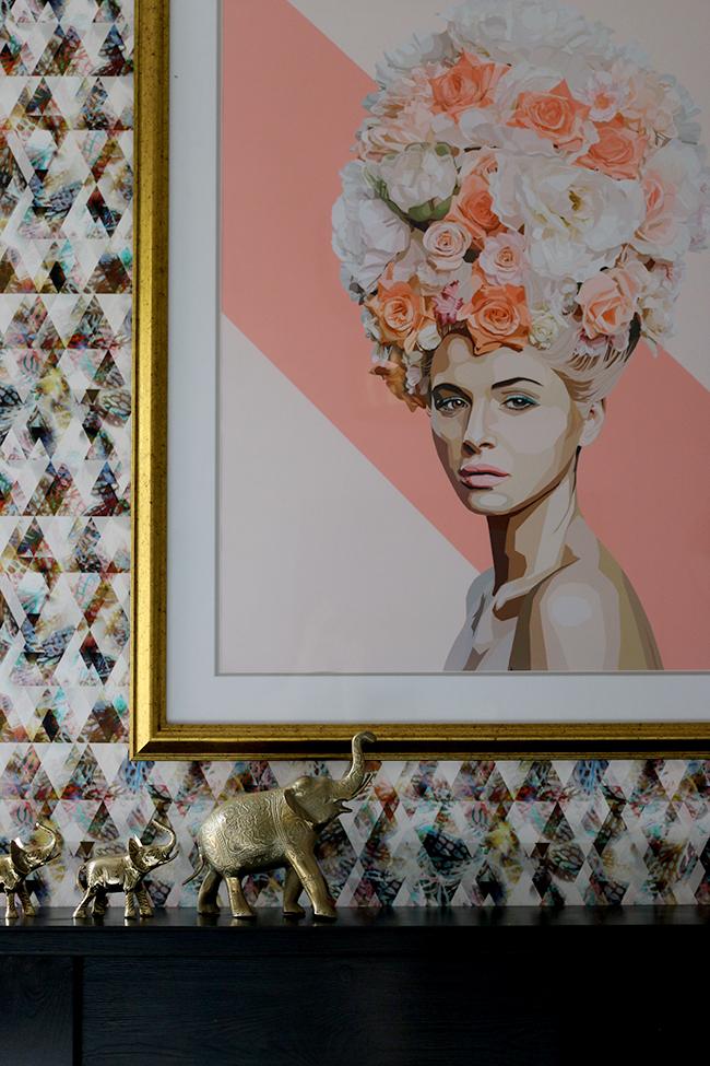 gina julian artwork against wallpaper
