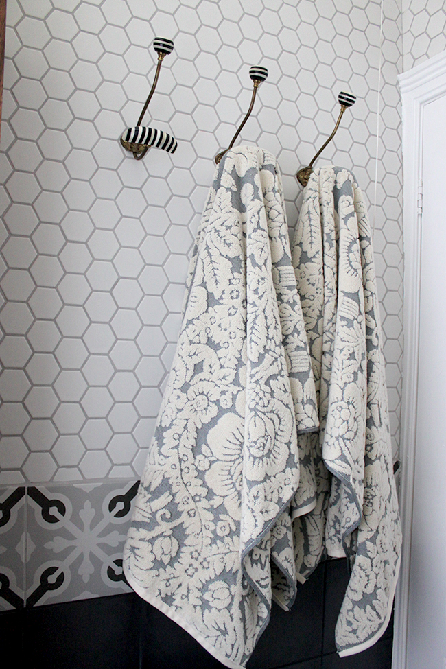 high quality towels on white hex tile background and anthropologie hooks