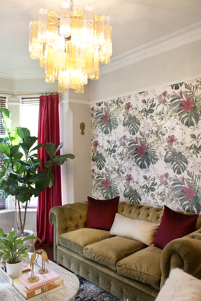 eclectic boho glam living room with tropical wallpaper and murano glass chandelier