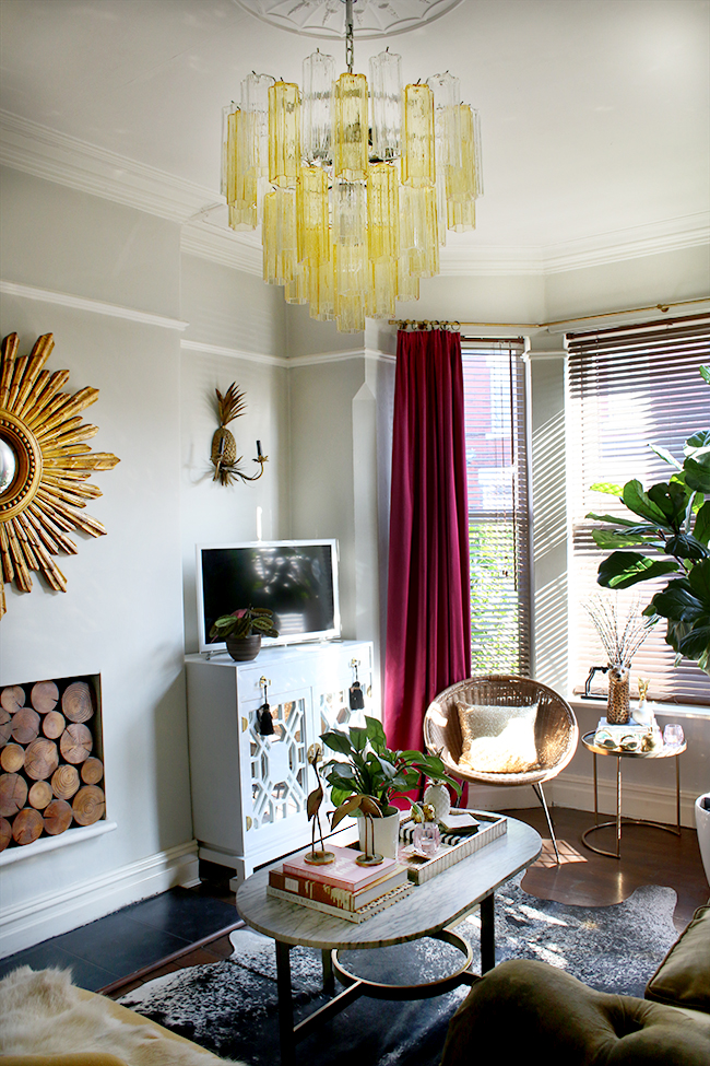 eclectic glam living room with murano glass chandelier