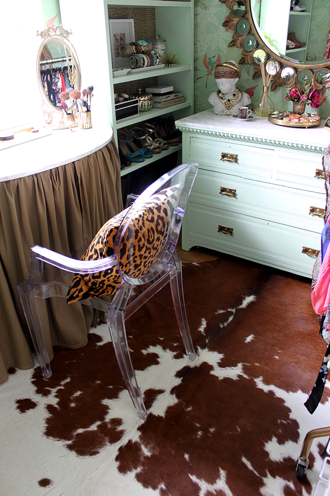 brown and white cowhide rug in dressing room