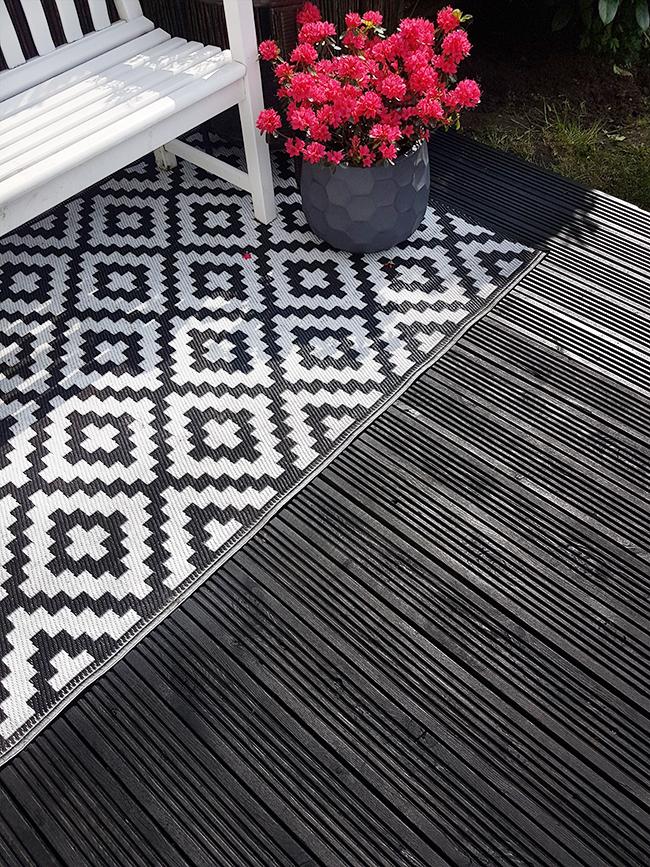 deck painted in Cuprinol Ash Black paint