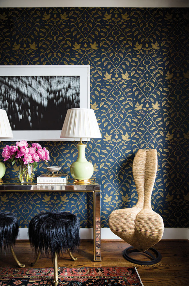 dark blue wallpaper wall with weird chair