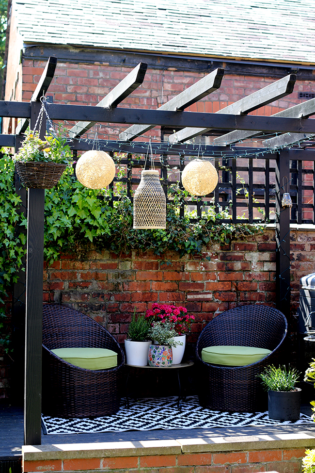 black pergola with bamboo lighting