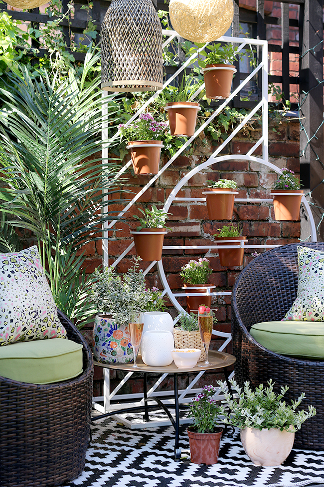 small garden design in Edwardian semi with two separate seating areas including a pergola