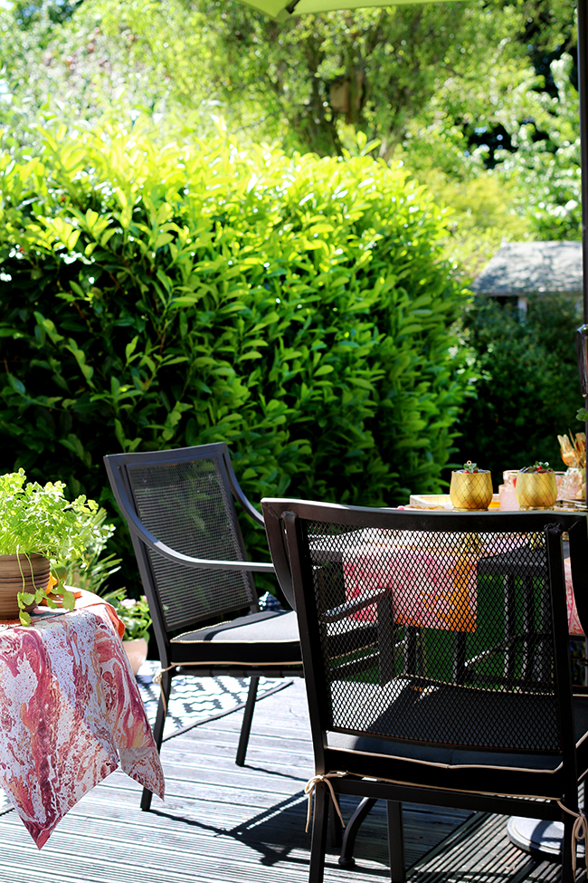 garden patio in black peach and pink with gold accents
