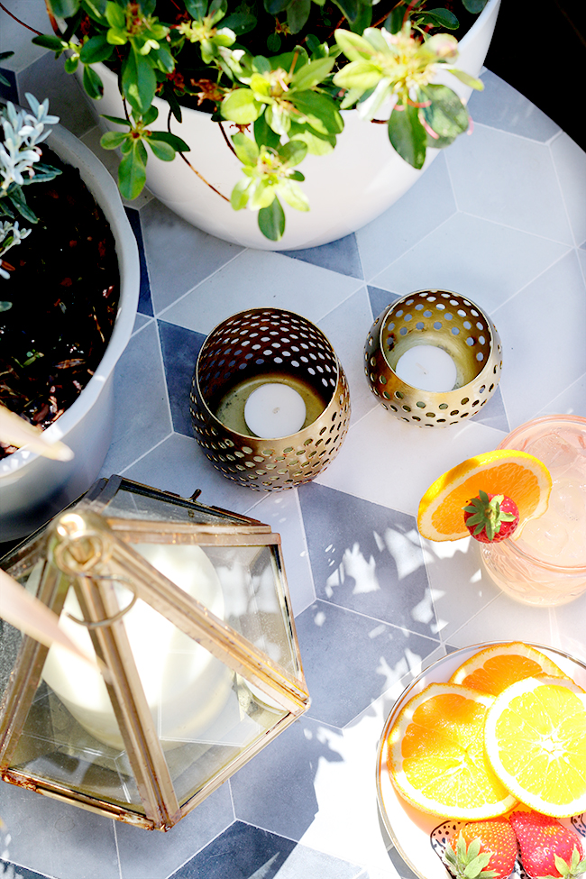 geometric garden side table with gold accents flatlay